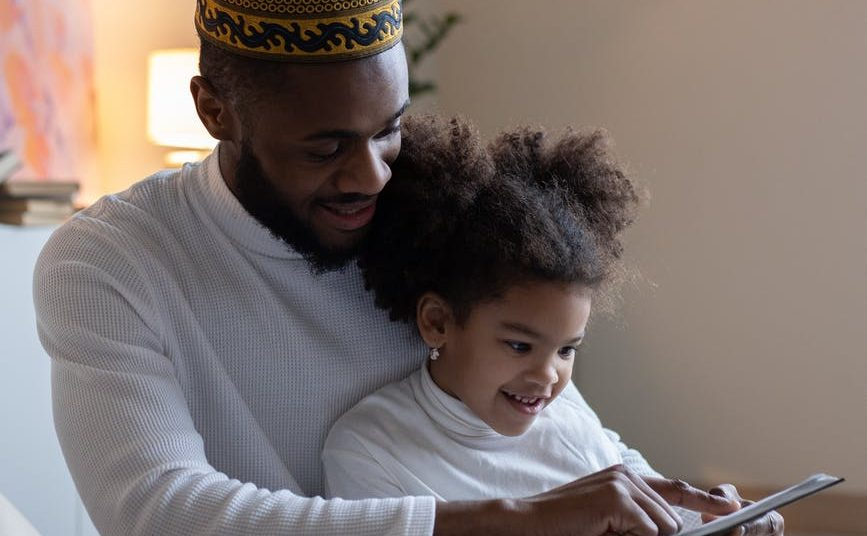 happy father with daughter reading book