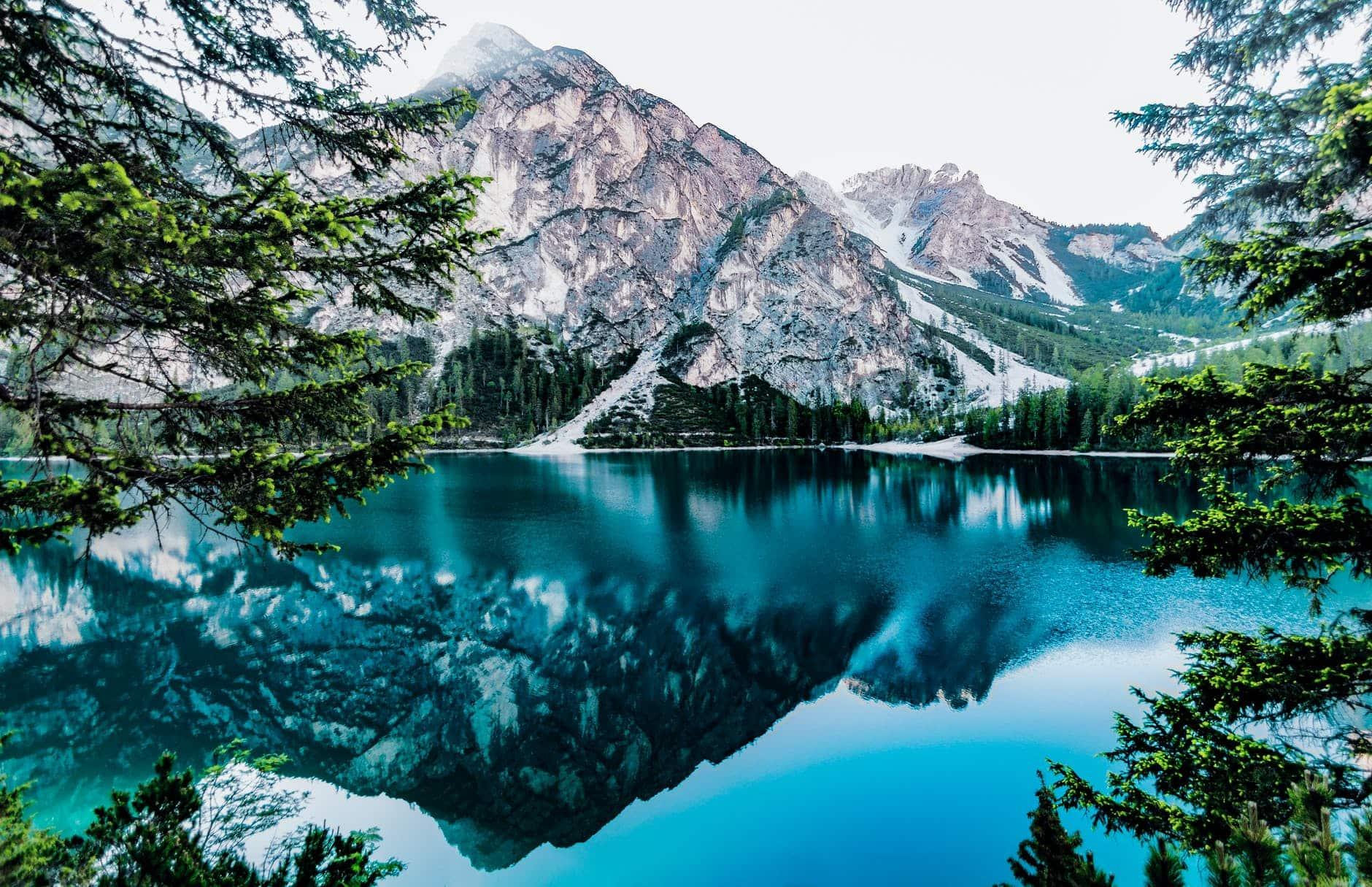lake and mountain under white sky